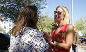 Kyrsten Sinema speaks to a supporter in Phoenix.