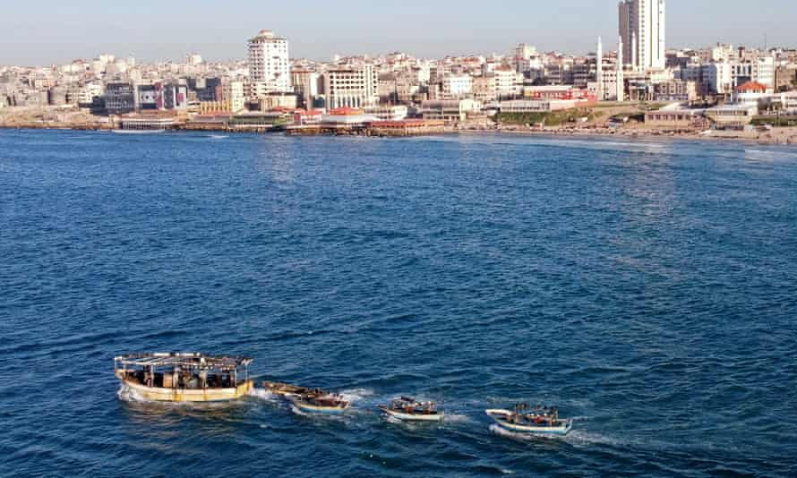 A picture taken with a drone shows Palestinian fishing boats near Gaza's seaport in Gaza City last month.