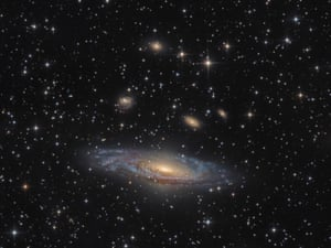Galaxies Runner up: NGC 7331 – The Deer Lick Group by Bernard Miller (USA) NGC 7331 is an unbarred spiral galaxy found some 40 million light years away from Earth, in the constellation Pegasus. Of the group of galaxies known as the Deer Lick Group, NGC 7331 is the largest, and can be seen dominating the image whilst the smaller galaxies NGC 7335, NGC 7336, NGC 7337, NGC 7338 and NGC 7340 drift above it. Animas, New Mexico, USA, 30 October 2016 PlaneWave CDK-17 17-inch reflector telescope at f/6.8, Paramount ME mount, Apogee CG16M camera, 18-hour total exposure