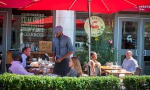 The Red Rooster restaurant on Lenox Avenue in Harlem, New York. US households spent more in restaurants in July, boosting consumer spending