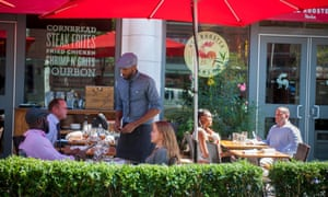 Patio at the Red Rooster restaurant on Lenox Avenue in the neighborhood of Harlem, US.