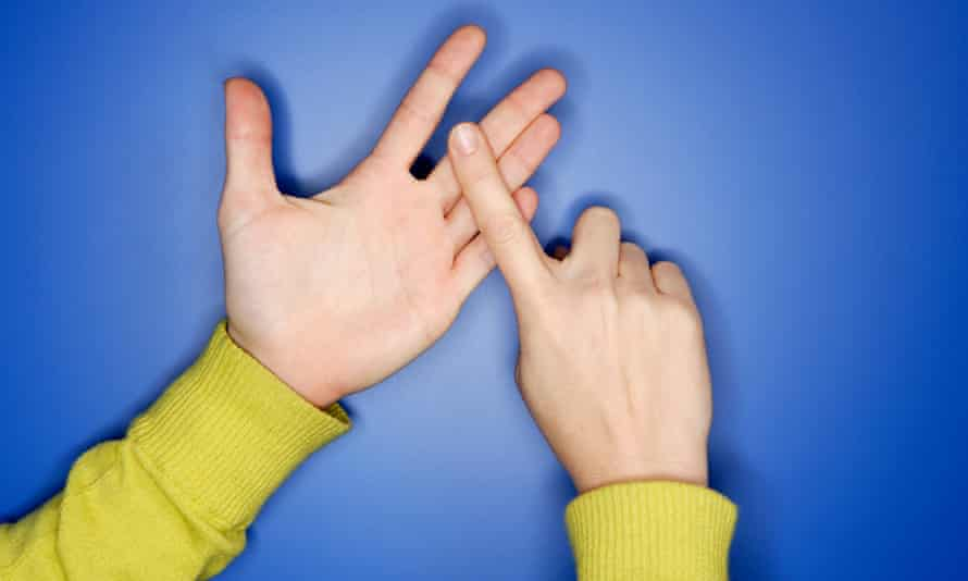 Woman's hands doing sign language