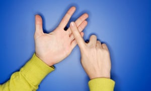 Woman's hands doing sign language.