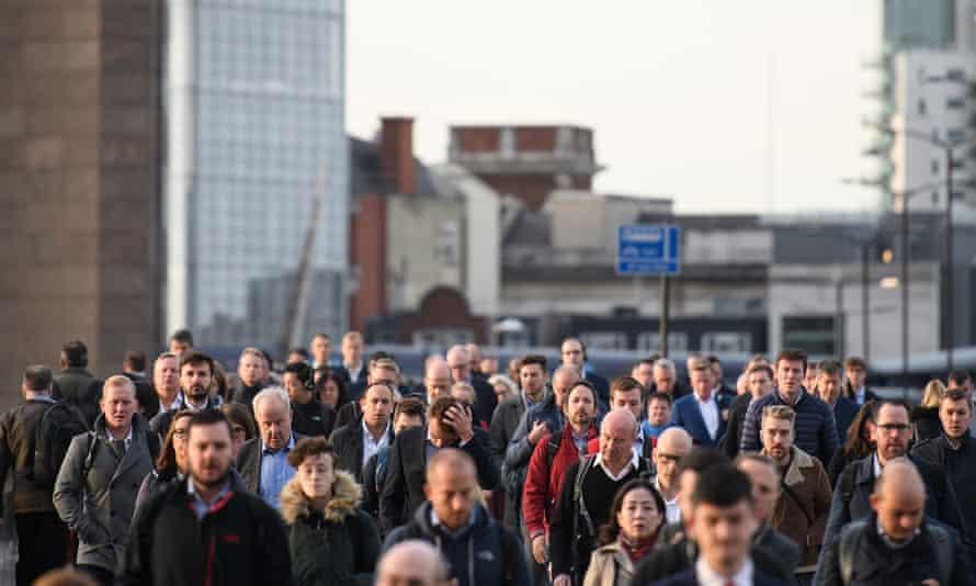Commuters head to work in London.
