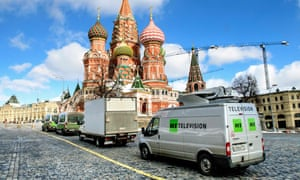 Russia's state-controlled Russia Today (RT) television broadcast vans are seen parked in front of St. Basil's Cathedral and the Kremlin next to Red Square in Moscow.