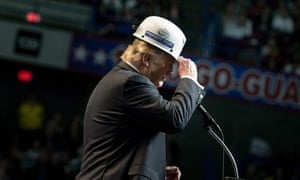 Donald Trump puts on a miner's hat while speaking during a rally in Charleston, West Virginia.