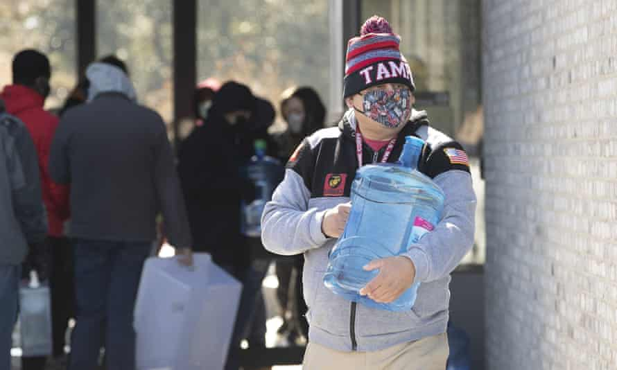 A water point for Austin residents whose pipes have burst. The Texas state capital reported losing 325m gallons of water due to burst pipes.