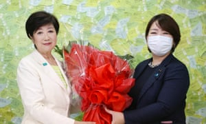 Tokyo governor Yuriko Koike receives a flower bouquet after winning the Tokyo gubernatorial election in Tokyo, Japan, 5 July 2020.