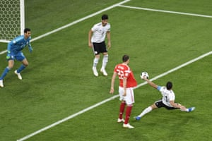 Egypt's defender Ahmed Fathi (R) deflects the ball into his own net.