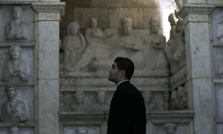 A priest visits the National Museum in Damascus as it reopens one wing