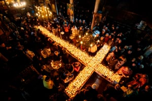 Blagoevgrad, BulgariaPeople pray around a cross-shaped platform covered with candles