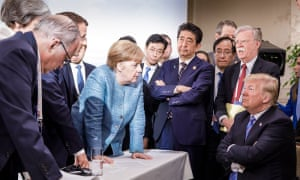 US president Donald Trump faces off with German chancellor Angela Merkel at the G7 Summit