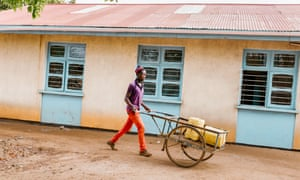 Water vendor Francis John comes to the Nyarugusu Dispensary after being called by patients' families. The water is collected at a borehole more than an hour's cycle away