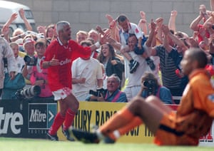 Fabrizio Ravanelli celebrates with Middlesbrough fans after scoring against Liverpool in 1996.