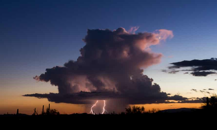 Storms in Arizona … GX Todd describes a 600-mile trek across a blitzed US in Defender. Photograph: Mike Olbinsk /Barcroft Images