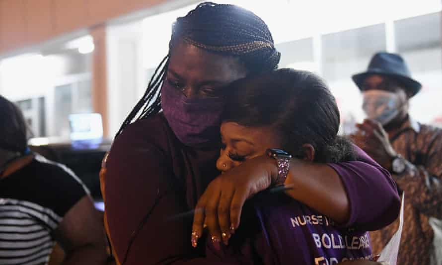 Cori Bush, left, hugs her daughter prior to giving her victory speech in St Louis, Missouri, on 4 August.