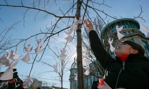 Ukrainians mark fifth anniversary of the violent Maidan protestsepa07378573 Ukrainians decorate a tree along a street with symbolic angels near the memorial for Maidan activists dubbed the 'Heroes of the Heavenly Hundred' and commemorating those who were killed on the Maidan during anti-government protests in 2014, not far from the Independence Square in Kiev, Ukraine, 18 February 2019. Ukrainians mark the fifth anniversary of the escalated violence in Maidan which resulted in at least 100 people being killed. EPA/SERGEY DOLZHENKO
