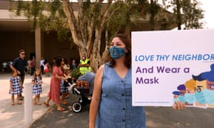 Sun Valley resident Aurora Perez reminds parishioners of Grace Community Church to wear a mask.