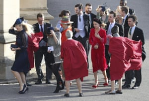 Chelsy Davy ( left) and other guests hold on to their hats