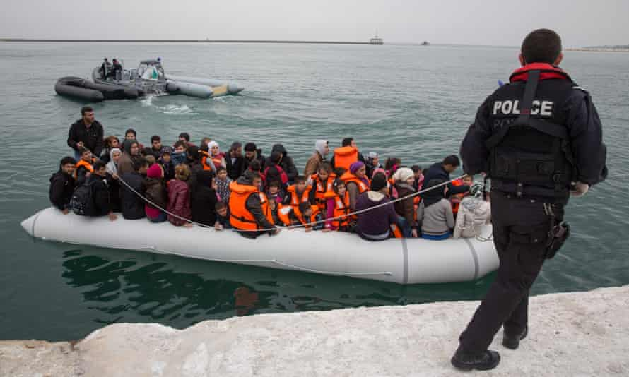 Refugees arrive by inflatable boat in Lesbos, Greece, 2 March.