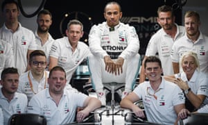 Lewis Hamilton poses for a photograph with his Mercedes team before this weekend's Abu Dhabi Grand Prix.