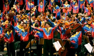 Gustavo Dudamel and the orchestra cheering at the end of one of their performances in Bremen, Germany, in 2007.