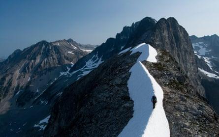 Female climber traversing snowy ridge, Redoubt Whatcom Traverse, North Cascades National Park, Washington state