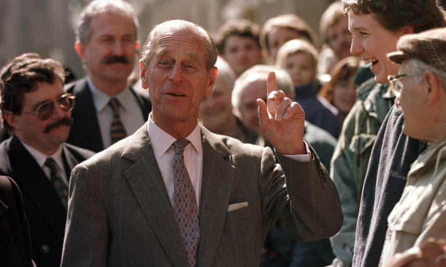Prince Philip shares a laugh with locals during a walking tour in the Czech town of Kutna Hora in 1996.