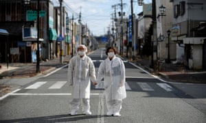 Couple hold hands on Fukushima street