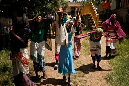 In Denkaka, Kebele, on 3 October, women mourn during the funeral of Tesfu Tadese Biru