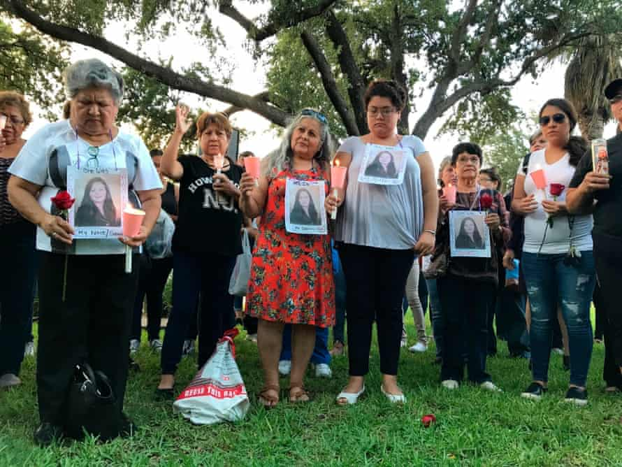 Dozens of family members and friends of the four women gather to grieve.