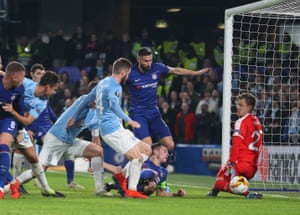 Cessar Azpilicueta of Chelsea, under a pile of Chelsea and Malmo players sees his shot saved by Malmo goalkeeper Johan Dahlin.