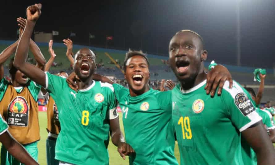Mbaye Diagne (right) celebrates with Cheikhou Kouyaté and Keita Baldé after reaching the 2019 Africa Cup of Nations final.