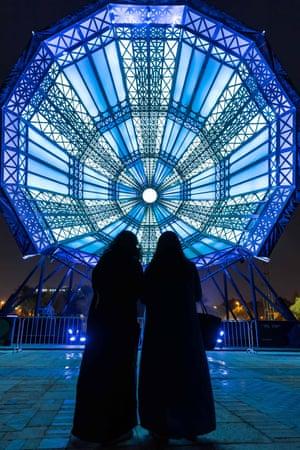Riyadh, Saudi Arabia. Visitors look at an art installation called The Cupola, during the Noor Riyadh light and art festival