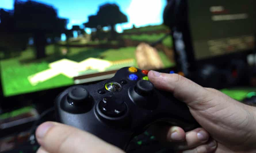 A gamer plays Minecraft on an Xbox One.