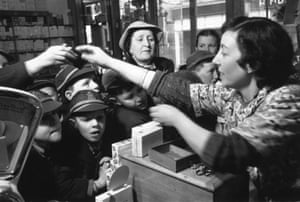 Buying Sweets, 1953. Excitement in the high street as sweet rationing ends