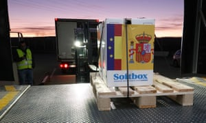 The Pfizer/BioNTech Covid-19 vaccine is downloaded from a refrigerated truck and stored in an undisclosed warehouse in Guadalajara, Spain.