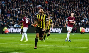 Troy Deeney celebrates opening the scoring with a penalty for Watford against West Ham.