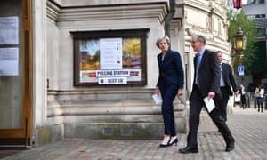 Britain's Prime Minister Theresa May and her husband Philip arrive at a polling station to vote in local elections in central London