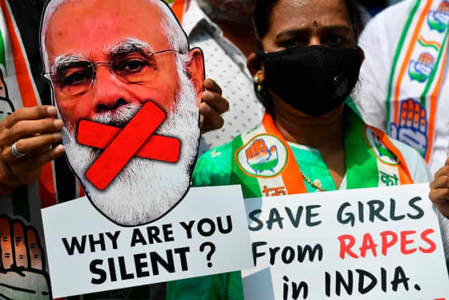 An activist holds a cut-out of India's prime minister, Narendra Modi, at a protest over another gang-rape and murder of a young woman in Uttar Pradesh state last year.