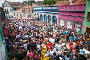 Revellers march at pre-carnival celebrations in Recife, Brazil