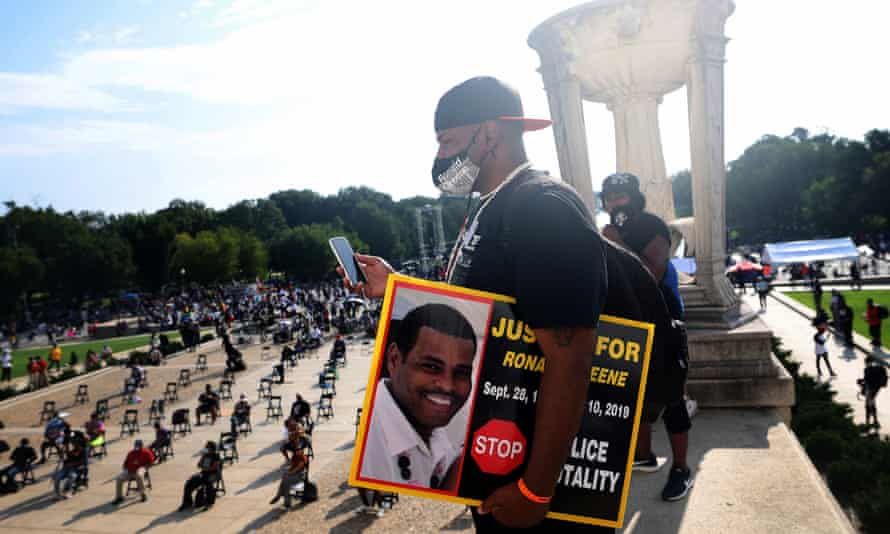 Sean Greene, Ronald's brother, at a protest in Washington last year. Greene's family said police told them he had died after his car crashed during a police pursuit.