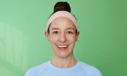 Zoe Williams in pink headband and bun