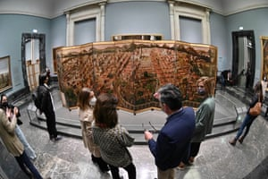 Madrid, SpainVisitors look at the Biombo with the Conquest of Mexico and View of Mexico City painting during its presentation at the Prado Museum. The artwork is dated back to the 17th century and belonged to the Dukes of Moctezuma, a Spanish noble family