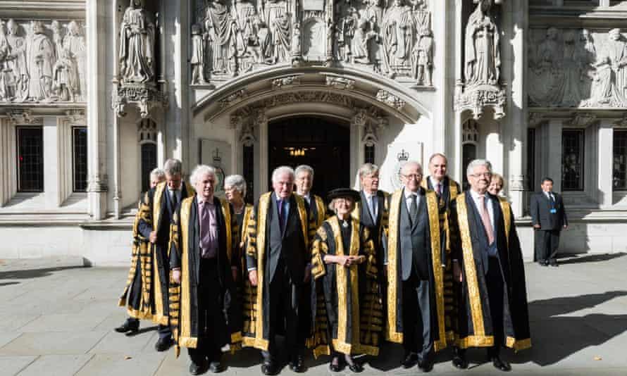 Twelve supreme court judges outside the court building.