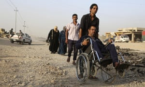 People flee during clashes between Iraqi security forces and Isis in Mosul
