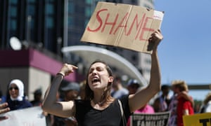 Protesters gathered outside the Detroit Economic Club in Detroit, where Donald Trump delivered his speech on Monday 8 August.
