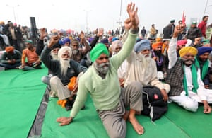 Farmers shout slogans as they take part in a sit-in at the Delhi-Uttar Pradesh border last month.