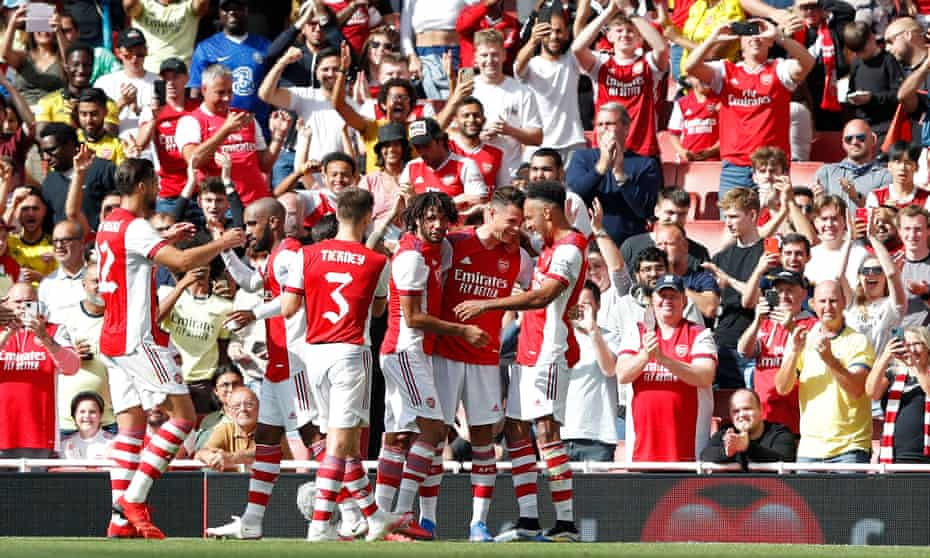 Granit Xhaka is congratulated after scoring in the friendly defeat to Chelsea.