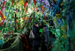 Kiev, Ukraine. Visitors attend the Wrapped in Plastic exhibition by the Ukrainian Vladi Yudi. The director used plastic in various shapes and forms to create settings for a horror cartoon